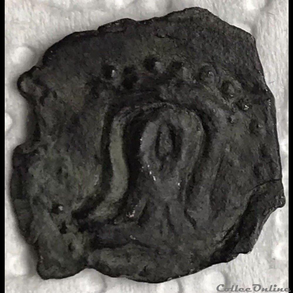 monnaie antique gauloise bronze a la tete de face et au cavalier
