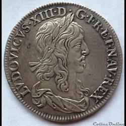 Demi écu de Warin 1er poinçon Louis XIII 1642 A rose